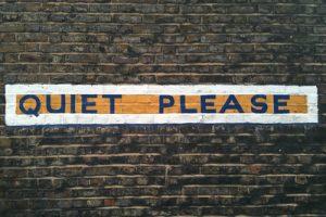 Quiet Please Painted over Bricks